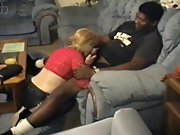 Lovely blonde cougar satisfies a muscle dark-hued man in couch